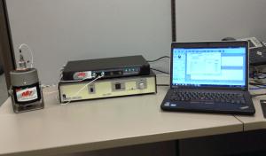 Accelerometer calibration setup with shaker, amp, accelerometers, controller, computer