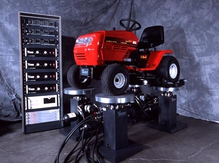 lawn mower on a four-post shaker system
