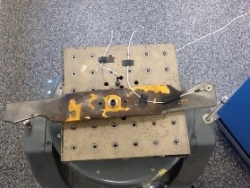 Figure 1: Lawnmower blade mounted on shaker