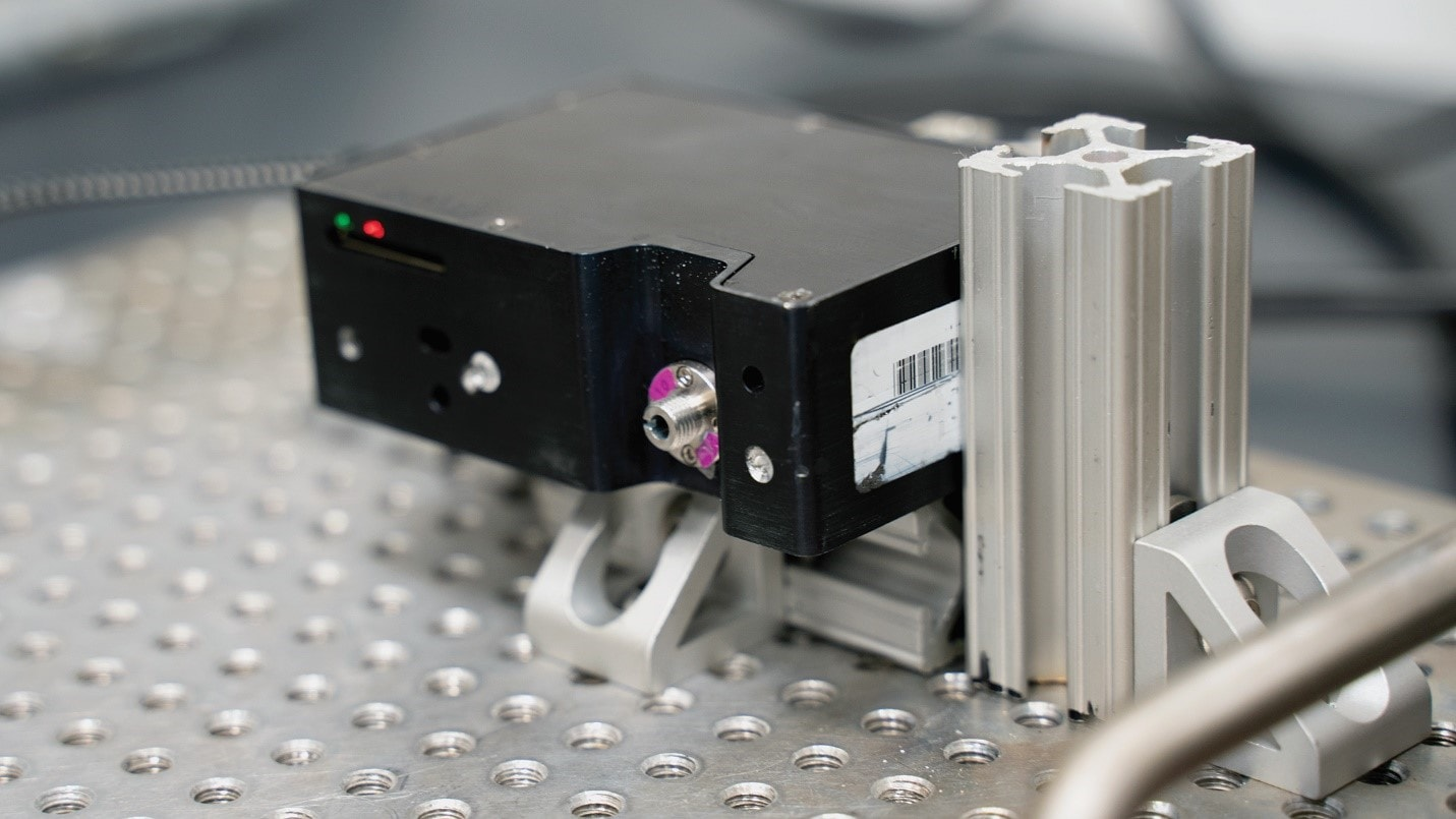 Spectrometer measuring light from a precise frequency source