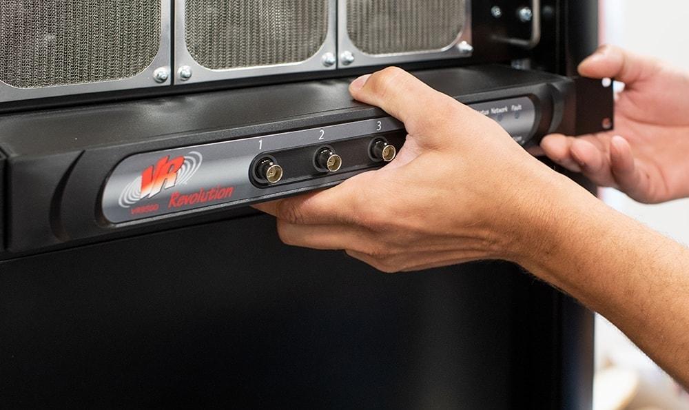 Inserting VR9500 Revolution Vibration Controller into cabinet