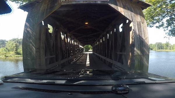driving through covered bridge